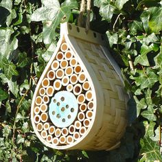 Made from FSC wood and hand-woven bamboo our Bee & Bug Hotel comes complete with a natural cord for hanging. This solitary bee nester is packed with drilled canes for nesting with the added feature of smaller holes for use by other beneficial insets s