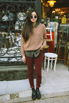 I have always loved the look of a simple sweater over a patterned button up. He pants are a gorgeous shade, And her low docs bring the whole outfit together!