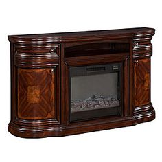 """60"""" Cherry Media Electric Fireplace $499.99 Home entertainment has never been more comfortable! Cozy up to this media fireplace with a rich cherry finish. Adorned with elegant ash burl details, a unique parquet top and doors with slow close hinges. Electronics not included.  Features:  4800 BTU 29"""" Fire insert with 1 year warranty Remote control Assembly required"""