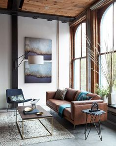 Modern living room with leather sofa, side chair, overarching lamp. Floor to cei… Modern living room with leather sofa, side chair, overarching lamp. Floor to ceiling windows. Modern Farmhouse Living Room Decor, Modern Farmhouse Decor, Living Design, Farmhouse Decor Living Room, Industrial Living Room Design, Living Decor, House Interior, Room Design, Room Decor