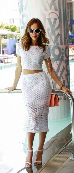High waisted skirt makes a crop top appropriate to wear. Love this white set