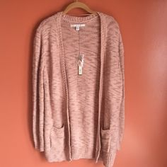 NWT LC Lauren Conrad Cardigan Sweater NWT LC Lauren Conrad Cardigan Sweater. Oversized boyfriend design, 2 pockets in the front, long sleeves, mixed stitch. Last picture is to show fit only, see first photo for true color. 97% Acrylic 3% Other Fibers. LC Lauren Conrad Sweaters Cardigans