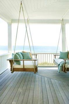 hanging bench bed overlooking beach