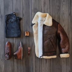 Fall outfit inspiration with a gray henley long sleeve shirt brown lambskin leather shearling lined bomber jacket black denim brown leather high top sneakers from johnston murphy brown leather banded grand frank watch Komplette Outfits, Cool Outfits, Fashion Outfits, Mens Fashion, Style Fashion, Stylish Mens Outfits, Casual Fall Outfits, Men Casual, Zalando Style