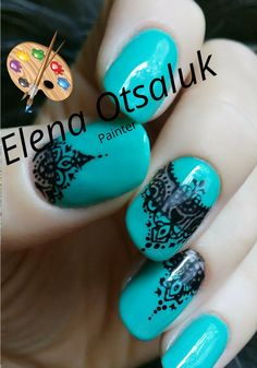 Turquoise manicure. Lacy painting