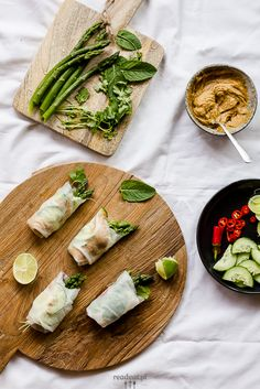 Asparagus spring rolls with peanut butter sauce, cucumber, hot pepper and fresh herbs.