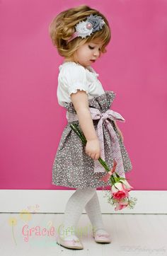 """How sweet is this little girl modeling our Gracie Graye's """"Bella"""" Skirt and matching headband."""