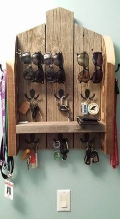 12 DIY Sunglasses Holders To Keep Your Sunnies Organized – DIY Ideas DIY Organizer. Use upcycled pallet wood to make this organization center. My next pallet wood project. Just need to get some coat hooks, wire, etc.