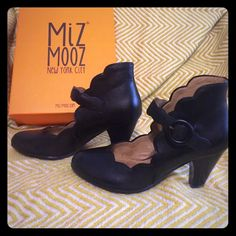 """Miz Mooz Carissa Black shoes size 8.5 Mary Jane style shoes with scalloped detail work around the edges and a high back. Heel is about 2 3/4"""" to 3"""" high. Near perfect condition with slight wear on the back of right heel and and a very small scrap on right toe that is only noticeable when you are looking close. Left shoe is perfect. Wore them half a dozen times for work, size too small. Purchased them a year ago but they are still available online brand new. Miz Mooz Shoes Heels"""