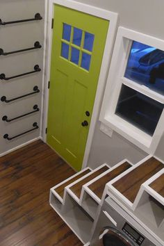 There are two lofts, one accessed by storage stairs and the other by a pipe ladder.