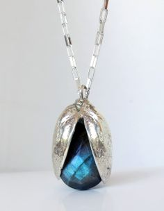 Pistachio Shell Casting with Faceted Labradorite. by Anna Vosburg Design