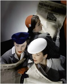 Models wearing hats and reading newspapers. Photography by Horst P. Horst. Vogue, February 15, 1943.  Three models in gray flannel suits all have eyes on the news. The relative simplicity of their suits underline the appropriation of the traditionally male role, but fashion isn't quite abandoned. Their hats make quite the style statement: from left, a blue felt visored beret, a red felt skullcap, and a white piqué beret.