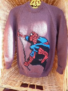 This sweater is for a 26 inch chest or a 3-4 year old.  It is knitted in the colour mink and has Spiderman on the front and is ready to go by Marionsknittedtoys on Etsy