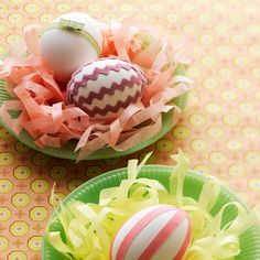 Paper Plate Egg Nest ~ Disposable plates and strips of crepe paper make for easy, inexpensive bird's nests. Use them as a simple centerpiece for your Easter displays... Editor's Tip: To get this look, glue rickrack or striped ribbon onto hard-boiled eggs. For even easier decorating, look for self-adhesive fabric tape in pretty colors and fun patterns