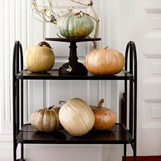 Coat light-color pumpkins with iridescent spray paint, and while the paint is wet, sprinkle iridescent glitter over the pumpkin: http://www.bhg.com/decorating/seasonal/fall/natural-fabulous-fall-decor/?socsrc=bhgpin102914luxepumpkins&page=2