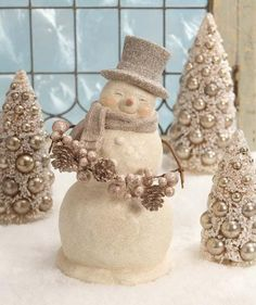 "Bring the joy of the season to your home with this heartwarming Smiley Snowman with Garland Figurine. Off white and champagne. 14"" x 8"". Bethany Lowe. Shop now!"