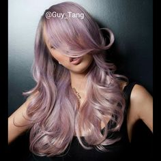 Very delicate lavender blond with slight pink ends by Guy Tang