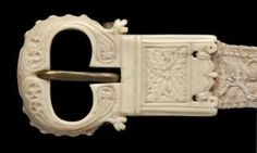 Belt buckle (ceinture) (Front: Male, St Trudo's Abbey S/n Ivory;fabric;metal Height: 39mm Width: 63mm Depth: 8mm Foliated decoration. Flamboyant tracery. Bruges 2010: Northern France or Flanders, 1st half of the 16th century.