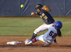 Florida's Justine McLean (52) slides safely into second base as the ball gets away from Michigan second baseman Sierra Romero during the second inning of the final game in the NCAA softball Women's College World Series Wednesday in Oklahoma City.