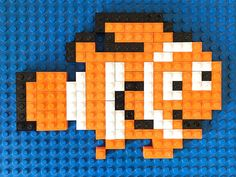 Finding Dory is finally here! We are so excited that we are celebrating its release with a new set of Lego mosaic patterns. Three fun designs in one totally free prinatble. Lego For Kids, Toys For Boys, Art For Kids, Boy Toys, Lego Projects, Sewing Projects, Deco Lego, Pictures Of Bricks, Lego Mosaic