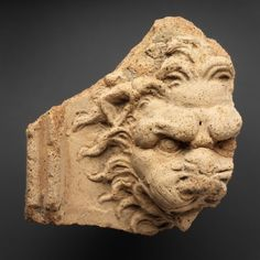 Etruscan; Italic style, Ancient, Relief Fragment of a lion's head, 5th - 3rd century BC, terracotta