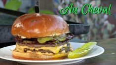 "The Au Cheval Cheeseburger is one of my all-time most requested copycats. I decided to go with the Double Cheeseburger, ""Au Cheval Style,"" which is three patties, two slices of cheese, thick-cut bacon, minced red onion, very thin sliced dill pickles, and dijonnaise, on fresh-baked brioche buns. Au Cheval also makes a ""single"" which is two beef patties and one slice of cheese."