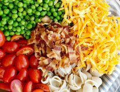 Creamy homemade ranch dressing coats every bite of pasta and vegetables in this Bacon Ranch Pasta Salad. Bacon and cheddar make it extra special! Easy Salad Recipes, Easy Salads, Summer Salads, Pasta Recipes, Appetizer Recipes, Vegan Recipes, Dinner Recipes, Cooking Recipes, Tomato Pasta Salad