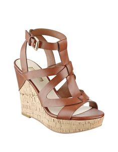 Heighten your wardrobe with these classic cork wedge sandals! Intricate brown strap detailing and gold-tone accents elevate this essential pair. Brown High Heels, Ankle Strap High Heels, Ankle Wrap Sandals, Strappy Sandals Heels, Platform Wedge Sandals, Brown Shoe, High Heels Stilettos, Strap Sandals, Wedge Shoes