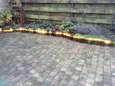 My garden project finished, a border of wine bottles with Xmas rope lights behind them.. Soo cool, :-)