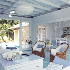 Key West cottage decorated in whites and wicker. Very tropical.