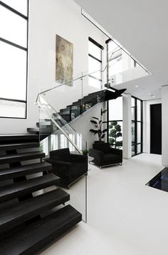 Love this black and white home...especially those black steps!!!!