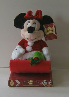 """Minnie in sled teeters back and forth singing """"Deck the Halls"""". Adorable festive Disney Singing Animated Friend. 