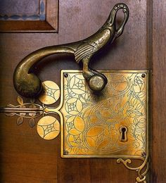 What a gorgeous art nouveau entry door handle!  The graceful bird lever perches on the intrically-etched lock plate.  Antique hardware such as this looks great on a period home.  We specialize in doors for historic homes in Minneapolis MN, and this one would be a terrific accent for many of them.  http://www.replacementwindowsmpls.com/