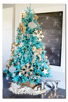Rustic Turquoise Christmas Tree. See 15 Amazing Christmas Trees on www.prettymyparty.com.