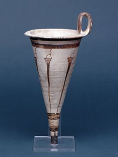 Pottery rhyton decorated with murex shells; vertical strap handle; decorated in red-black paint on buff ground; six murex-shells arranged horizontally around the vase; Late Helladic IIIB.