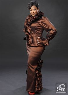 Available in all colors and sizes online or call Tawni Haynes Floor Length Evening Skirt with ruffle detail. Intricate ruffle detailing adorns the bottom back half of this skirt bringing a lot of fancy flare. Church Clothes, Church Dresses, Women's Dresses, African Attire, African Fashion Dresses, African Dress, Church Attire, Church Suits, Classy Dress