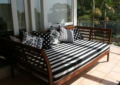 day bed on the patio in black and white stripes