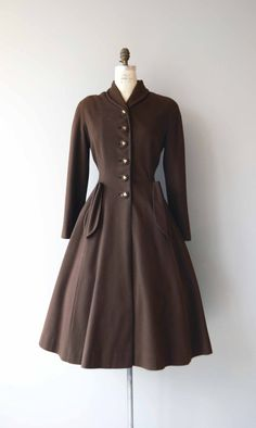 Amazing vintage 1950s milk chocolate brown wool princess coat with small shawl collar, fantastic brass studded buttons, panel construction, fitted waist, outer folded pockets and espresso satin lining. --- M E A S U R E M E N T S --- fits like: small/medium shoulder: n/a bust: 32-36 waist: 30 hip: free sleeve: approx. 22.5 length: 46 brand/maker: Bonwit Teller condition: excellent ★ layaway is available for this item ➸ More vintage coats http://www.etsy.com/s...