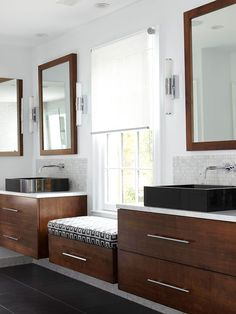 Elevate Style - In keeping with this bathroom's modern style, a floating maple cabinet perched between vanities provides extra storage and takes advantage of views. A barely-there solar shade above the window seat ushers natural light while providing privacy.