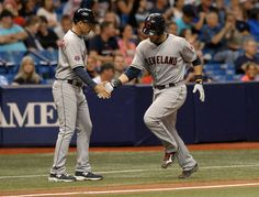 Mike Sarbaugh, congratulates Yan Gomes after his solo home run off Tampa Bay Rays reliever Kirby Yates during the eighth inning Monday, June 29, 2015, in St. Petersburg, Fla. The Indians defeated the Rays 7-1. (AP Photo/Steve Nesius)