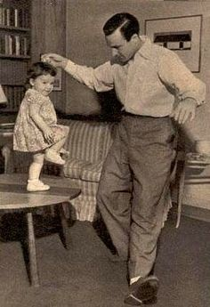 Gene Kelly teaches his daughter, Kerry, to dance. Why couldn't gene Kelly be my dad?
