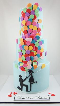 Perfect engagement cake to celebrate your love.  Proposal, fun, balloons, three tier, colorful cake
