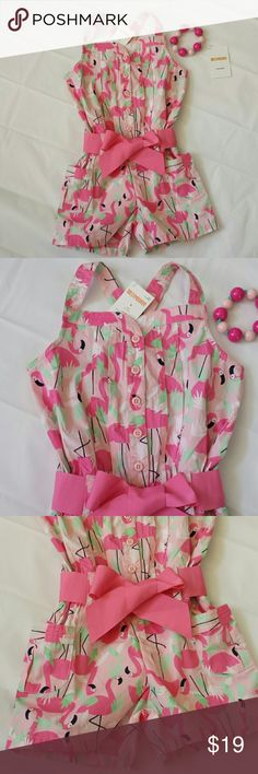 NWT - Gymboree Girls Size 5 Romper So cute, we love this little pink flamingo print girls romper! Button up the front for ease, cute criss-cross back, and front pockets and pink sash for style! ♡ So adorable on! Made by Gymboree, 100% cotton, machine washable. Matching bracelet is a must, so it comes with this sweet little romper!! Gymboree Bottoms Jumpsuits & Rompers
