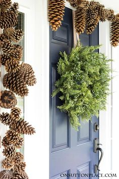 Christmas Front Door Decor   Juniper & Pinecones   Easy, natural ideas for decorating your front door for Christmas. Includes white lights & grapevine.