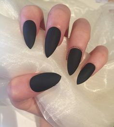 Lovely matte black stiletto nails - http://shoebrand.net/beautiful-matte-black-stiletto-nails/