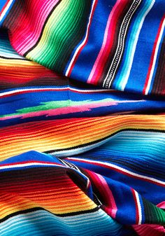 Polychromatic Cuddles Throw Blanket. Envelop yourself in the kaleidoscopic colors that form this rainbow-streaked blanket by Karma Living! #multi #modcloth