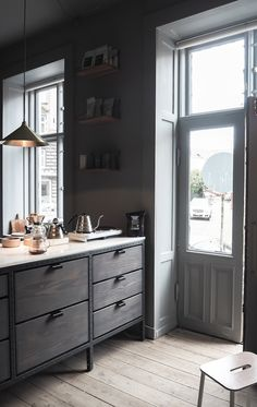 dark stained kitchen unit and grey walls... New Frama Copenhagen