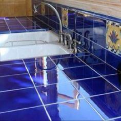 Jaw-Dropping: Unique Kitchen Tile Ideas You'll Want For Your Home: Idea: Glossy, Blue Spanish-Style Tile on Kitchen Counter Blue Tile Backsplash Kitchen, Kitchen Paint, Backsplash Ideas, Design Kitchen, Kitchen Ideas, Blue Countertops, Kitchen Countertops, Tile Counters, Floors Kitchen