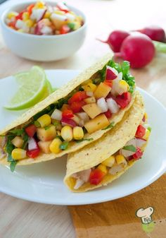 Pork and Nectarine Tacos Recipe  : Tacos don't have to be dripping with cheese and loaded with fat. Try these colorful and tasty pork tacos topped with a sweet and spicy fruit salsa.