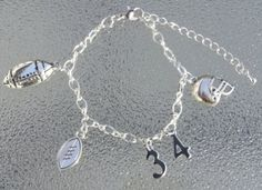 This is a 7 1/4 inch football charm bracelet with a 2 inch metal extension. The…